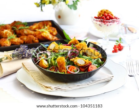 Summer lunch - vegetable salad with chicken wings and yogurt dessert - stock photo