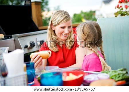 Summer: Mother And Daughter Get Ready To Eat Dinner - stock photo