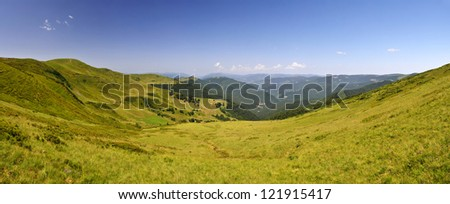 Summer mountain landscape. Meadows under blue sky - stock photo