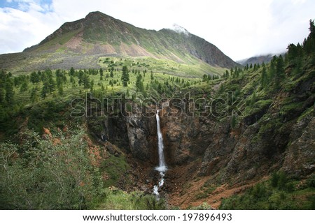Summer mountain landscape small waterfall in mountain East Sayan - stock photo
