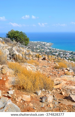 Summer mountain landscape with dry grass and overlooking the Aegean Sea. in Crete, Greece. - stock photo