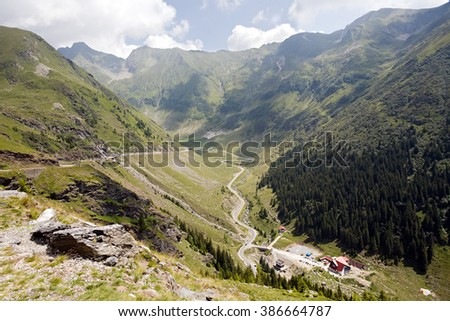 summer mountain landscape with winding highway road, Romania - stock photo