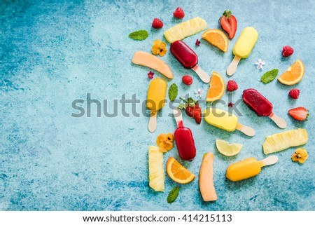 summer natural popsicle border background, flat lay from overhead - stock photo