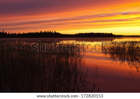 Summer night in colorful sunset Finnish Lapland - stock photo