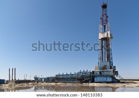 Summer oil rig - stock photo