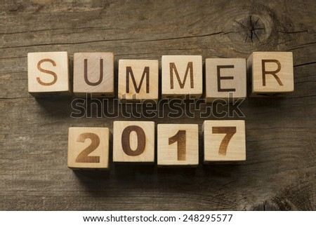 Summer 2017 on a wooden background - stock photo