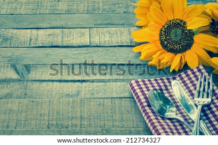 Summer or Fall Picnic Place setting with Sunflower on Rustic Wood Board Background with Room or space for copy, text, your words.  Horizontal instagram - stock photo