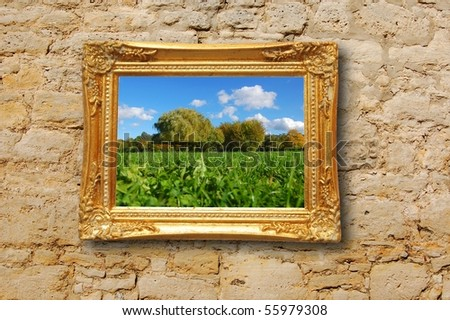 summer painting or picture in image frame on a wall - stock photo