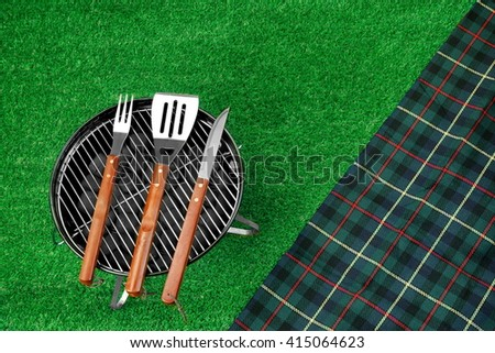 Summer Picnic Scene On The Lawn. Portable Barbecue Grill, Tools And Blanket. Top View - stock photo
