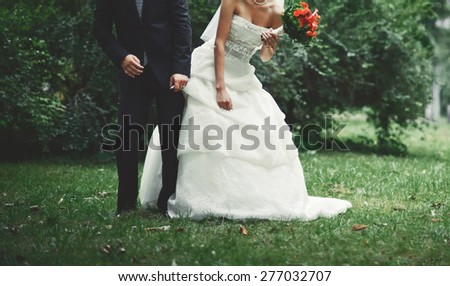 Summer picture of happy wedding couple outside.  - stock photo
