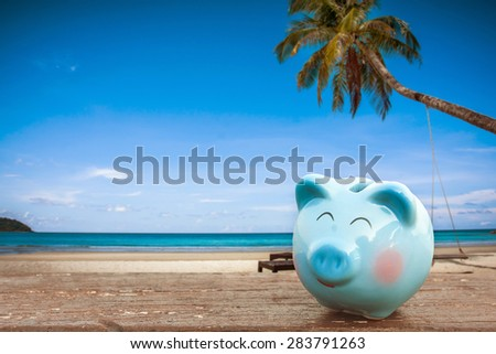 summer piggy bank on the beach - stock photo