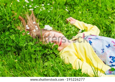 Summer portrait of a cute little girl on a nice sunny day - stock photo