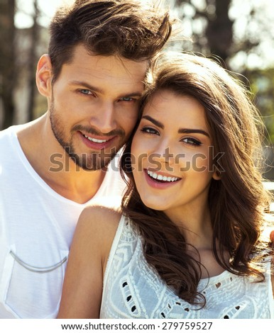 Summer portrait of beautiful happy couple  - stock photo