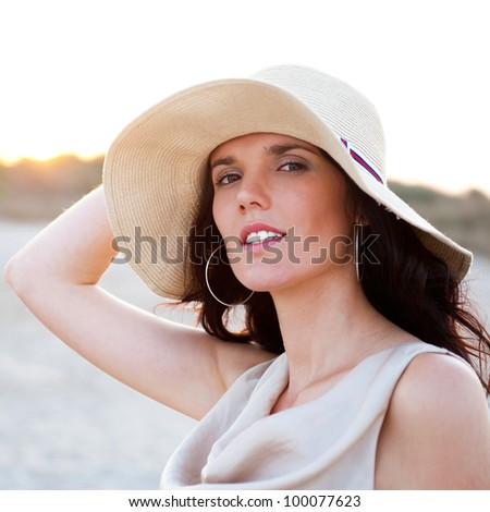 Summer portrait of beautiful woman wearing hat. Vacation at warm country - stock photo