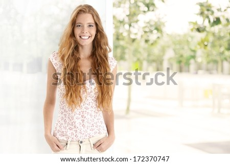 Summer portrait of long hair gingerish woman, smiling happy, looking at camera. Plenty of copyspace. - stock photo