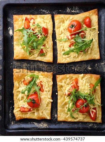 summer puff pie with tomato, food top view - stock photo
