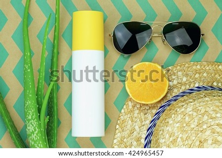 Summer refreshment, Natural and chemical sunscreen protection, Sunglasses, Aloe vera, Fresh fruit, Straw hat, Suncreen lotion. (Color Process) - stock photo