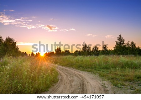 summer rural landscape with  blue sky, the road.  sunrise - stock photo