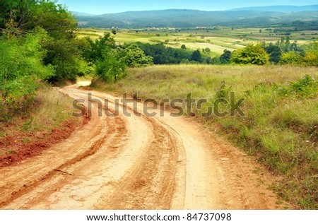 summer rural road and landscape of central Serbia - stock photo