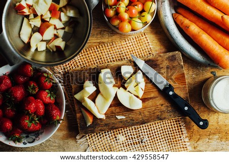 Summer salad with fresh home-natural fruits and vegetables. Preparing  salad with strawberry, apple and carrot on summer day. Healthy, dieting, vegetarian food. Nutrition concept. Healthy eating - stock photo