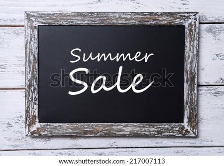 Summer sale written on chalkboard, close-up - stock photo