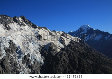 Summer scene in the Southern Alps. Huddleston and Tuckett glacier. Mt Cook, highest mountain of New Zealand. - stock photo