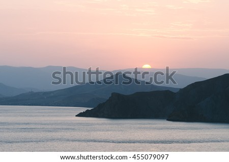Summer sea landscape. View of the mountains and the setting sun. Crimea, Ukraine, Europe. Color toning - stock photo