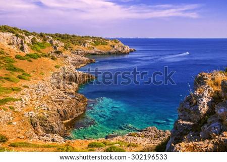 SUMMER SEASCAPE.Salento coast: Bay Uluzzo (Lecce).ITALY (Apulia).In the background the city of Gallipoli.Bay Uluzzo is a small natural gulf located within the protected area known as Porto Selvaggio.  - stock photo