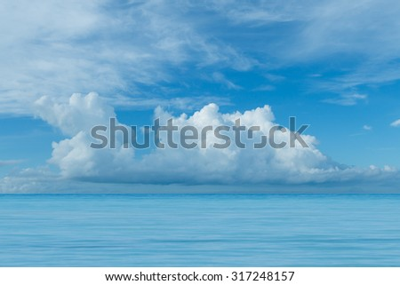 Summer seascape with blue sea sky and big white cloud background - stock photo
