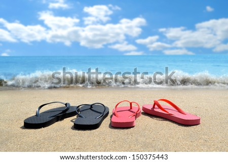 summer shoes on the beach - stock photo