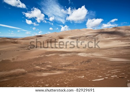 Summer sky and and sand in Sand Dunes National Park, Colorado - stock photo