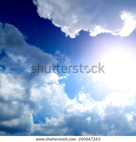 Summer Sky Cloudscape Area with Ray of Light - stock photo