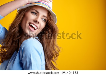 Summer smiling woman in studio portrait  - stock photo