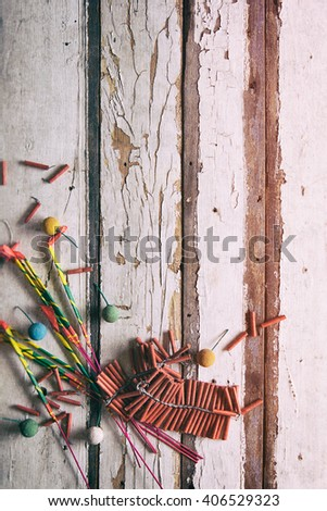 Summer: Sparkler And Firecrackers On Wooden Background - stock photo