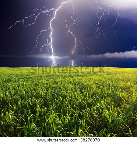 summer storm beginning with lightning - stock photo