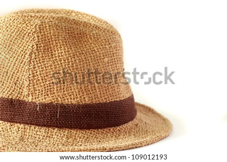 Summer straw hat on white background - stock photo