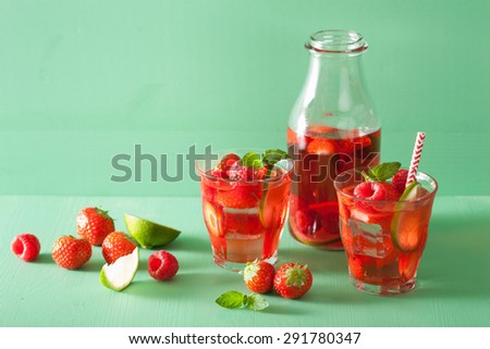 summer strawberry raspberry lemonade with lime and mint - stock photo