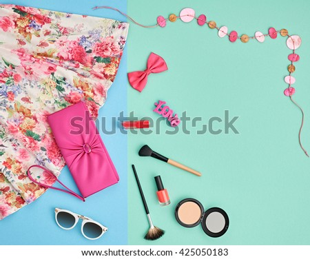 Summer.Summer fashion.Girl clothes accessories set.Woman essentials. Cosmetics, makeup.Stylish handbag clutch, dress, necklace, sunglasses .Unusual overhead summer outfit, summer top view on pink - stock photo