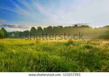 summer sunrise over the rural areas and a meadow - stock photo
