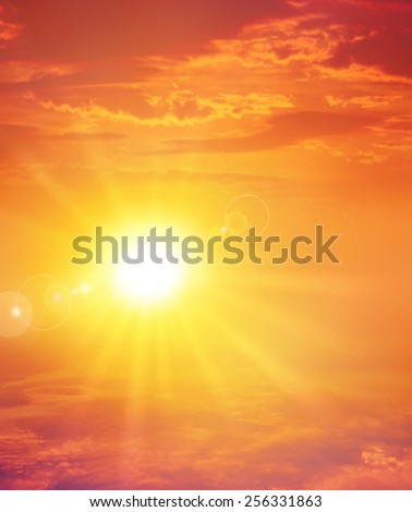 Summer sunset. The setting sun in a cloudy sky background - stock photo