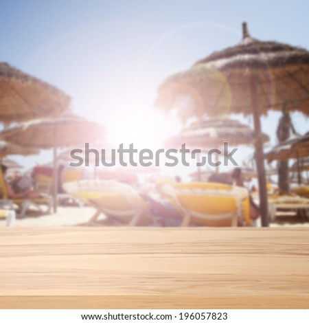 summer table and beach  - stock photo