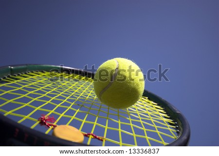 Summer Tennis - Close up of a tennis ball and racket - stock photo