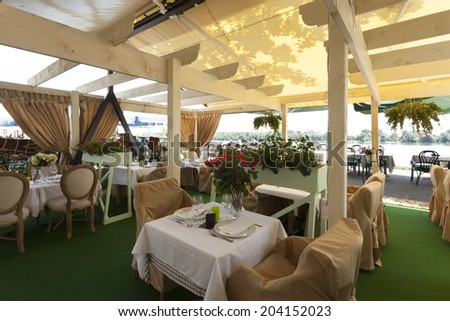 Summer terrace cafe interior - stock photo