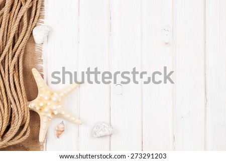 Summer time sea vacation background with star fish, marine rope and copy space - stock photo