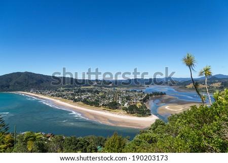 Summer top view of Tairua town and harbor from Paku mountain, the Coromandel peninsula, New Zealand - stock photo