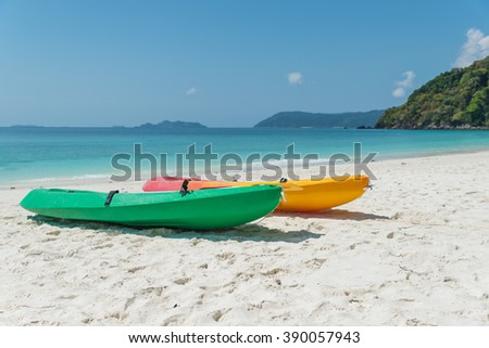 Summer, Travel, Vacation and Holiday concept - Colorful kayaks on the tropical beach, Thailand - stock photo