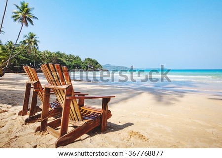 summer tropical holidays, beach hotel in sunny day, vacations on paradise island, background with place for text - stock photo
