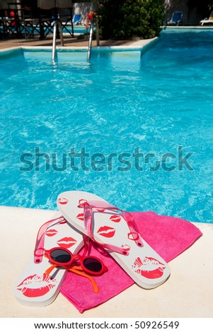 Summer vacation at the swimming pool with attributes - stock photo