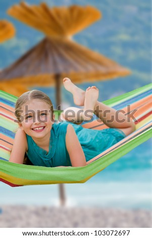 Summer vacation, beach resort- lovely girl in colorful hammock - stock photo
