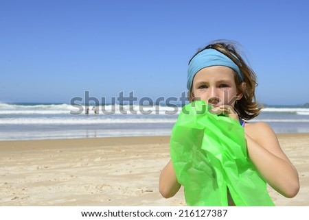 Summer vacation: Child inflating inflatable swim ring on the beach - stock photo